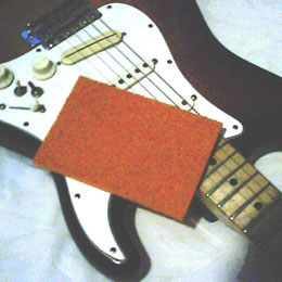 Synthetic scouring pad used for wiping guitar strings