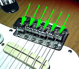 Guitar bridge assembly with individual mount and adjustable screw for setting intonation of each string